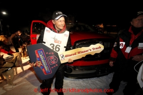 Mitch Seavey, 53, holds the key to the winning Dodge truck, after pulling into Nome first and winning his second Iditarod sled dog race on Tuesday March 12, 2013. Seavey made the journey from Willow in 9 days, 7 hours, 39 minutes, 56 seconds. Iditarod Sled Dog Race 2013Photo by Jeff Schultz copyright 2013 DO NOT REPRODUCE WITHOUT PERMISSION