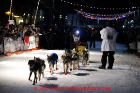 Mitch Seavey drives his team down Front Street in Nome first and winning his second Iditarod sled dog race on Tuesday March 12, 2013. Seavey made the journey from Willow in 9 days, 7 hours, 39 minutes, 56 seconds. Iditarod Sled Dog Race 2013Photo by Jeff Schultz copyright 2013 DO NOT REPRODUCE WITHOUT PERMISSION