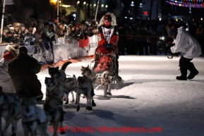 Aily Zirkle comes down Front Street with her team in Nome on Tuesday March 12, 2013.Iditarod Sled Dog Race 2013Photo by Jeff Schultz copyright 2013 DO NOT REPRODUCE WITHOUT PERMISSION