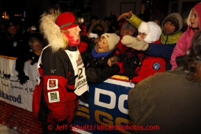 Aily Zirkle is greeted by race fans after arriving second in Nome on Tuesday March 12, 2013.Iditarod Sled Dog Race 2013Photo by Jeff Schultz copyright 2013 DO NOT REPRODUCE WITHOUT PERMISSION