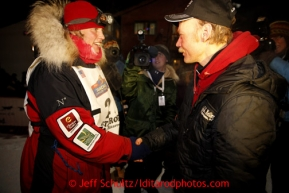 Aily Zirkle, left, shakes hands with Iditarod winner Mitch Seavey after she pulled into Nome minutes after him on Tuesday March 12, 2013.Iditarod Sled Dog Race 2013Photo by Jeff Schultz copyright 2013 DO NOT REPRODUCE WITHOUT PERMISSION