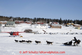 Pete Kaiser runs down the Fish River as he makes his way into the White Mountain checkpoint on Tuesday March 12, 2013.Iditarod Sled Dog Race 2013Photo by Jeff Schultz copyright 2013 DO NOT REPRODUCE WITHOUT PERMISSION
