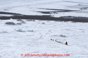 Mitch Seavey runs down Topkok hill on his way to Safety and Nome on Tuesday March 12, 2013.Iditarod Sled Dog Race 2013Photo by Jeff Schultz copyright 2013 DO NOT REPRODUCE WITHOUT PERMISSION