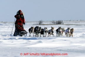 Aily Zirkle races near Cape Nome on Tuesday March 12, 2013.Iditarod Sled Dog Race 2013Photo by Jeff Schultz copyright 2013 DO NOT REPRODUCE WITHOUT PERMISSION