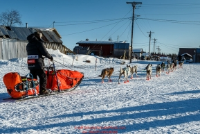 Ralph Johannessen runs down the road as he arrives at the Kaltag checkpoint on Saturday March 12th during the 2016 Iditarod.  Alaska    Photo by Jeff Schultz (C) 2016  ALL RIGHTS RESERVED