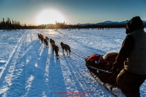 Hugh Neff runs down the trail after leaving the Kaltag checkpoint near sunset on Saturday March 12th during the 2016 Iditarod.  Alaska    Photo by Jeff Schultz (C) 2016  ALL RIGHTS RESERVED