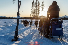 Scott Smith and team run down the trail near sunset after leaving the Kaltag checkpoint on Saturday March 12th during the 2016 Iditarod.  Alaska    Photo by Jeff Schultz (C) 2016  ALL RIGHTS RESERVED