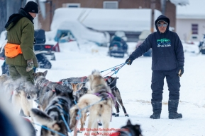 Race Judge Kevin Sakai holds John Baker's team as John checks into the Kaltag checkpoint during the 2017 Iditarod on Sunday morning March 12, 2017.Photo by Jeff Schultz/SchultzPhoto.com  (C) 2017  ALL RIGHTS RESERVED