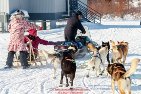 Mats Pettersson is escorted through town by race judge Kevin Saiki and two 12-year old girls riding a sled at the Kaltag checkpoint during the 2017 Iditarod on Sunday afternoon March 12, 2017.Photo by Jeff Schultz/SchultzPhoto.com  (C) 2017  ALL RIGHTS RESERVED