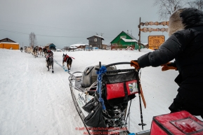 John Baker runs up the Yukon riverbank as he gets into the Kaltag checkpoint during the 2017 Iditarod on Sunday morning March 12, 2017.Photo by Jeff Schultz/SchultzPhoto.com  (C) 2017  ALL RIGHTS RESERVED