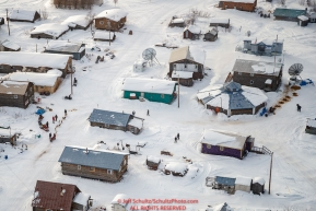 Paul Gebhardt checks in at the fire hall building checkpoint as other teams rest around the community center at the Kaltag checkpoint during the 2017 Iditarod on Sunday afternoon March 12, 2017.Photo by Jeff Schultz/SchultzPhoto.com  (C) 2017  ALL RIGHTS RESERVED