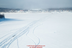 Jason Mackey runs down the Yukon River with Kaltag in the background during the 2017 Iditarod on Sunday afternoon March 12, 2017.Photo by Jeff Schultz/SchultzPhoto.com  (C) 2017  ALL RIGHTS RESERVED