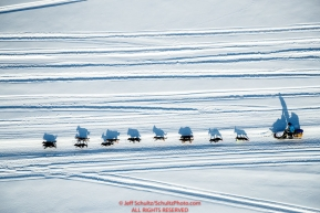 Jason Mackey runs on the Yukon River with many snowmachine tracks running alongside on the trail nearng the Kaltag checkpoint during the 2017 Iditarod on Sunday afternoon March 12, 2017.Photo by Jeff Schultz/SchultzPhoto.com  (C) 2017  ALL RIGHTS RESERVED