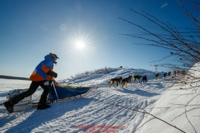 Mats Pettersson runs up the bank of the Yukon River and into  the Kaltag checkpoint during the 2017 Iditarod on Sunday afternoon March 12, 2017.Photo by Jeff Schultz/SchultzPhoto.com  (C) 2017  ALL RIGHTS RESERVED