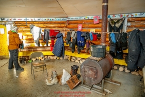 Katherine Keith puts up some of her clothes to dry over a wood stove in the community center at the Kaltag checkpoint during the 2017 Iditarod on Sunday evening  March 12, 2017.Photo by Jeff Schultz/SchultzPhoto.com  (C) 2017  ALL RIGHTS RESERVED