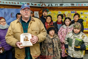 Richard Burnham, on behalf of the entire family accepts the Herbie Nayokupuk Spirit of Iditarod for his father-in-law Austin Esmailka at the Kaltag checkpoint during the 2017 Iditarod on Sunday morning March 12, 2017.Photo by Jeff Schultz/SchultzPhoto.com  (C) 2017  ALL RIGHTS RESERVED