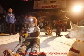Jeff King lies with his lead dog Skeeter in the finish chute after finishing in 3rd place in Nome on Wednesday March 13, 2013.Iditarod Sled Dog Race 2013Photo by Jeff Schultz copyright 2013 DO NOT REPRODUCE WITHOUT PERMISSION