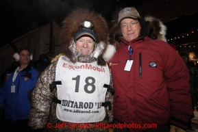Jeff King poses with race sponsor Stan Foo representing Donlin Gold after finishing in 3rd place in Nome on Wednesday March 13, 2013.Iditarod Sled Dog Race 2013Photo by Jeff Schultz copyright 2013 DO NOT REPRODUCE WITHOUT PERMISSION