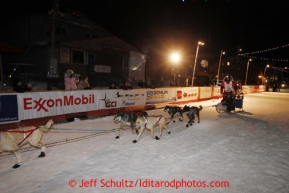 Ray Redington Jr. runs down the finish chute in Nome to place fifth on Wednesday March 13, 2013. Iditarod Sled Dog Race 2013Photo by Jeff Schultz copyright 2013 DO NOT REPRODUCE WITHOUT PERMISSION