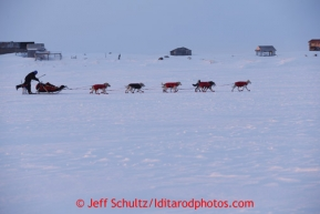 Paul Gebhart runs on the trail past Farley's camp several miles before the finish line in Nome on Wednesday March 13, 2013. Iditarod Sled Dog Race 2013Photo by Jeff Schultz copyright 2013 DO NOT REPRODUCE WITHOUT PERMISSION