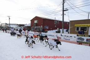 Martin Buser runs down Front Street and into the finish chute to place 17th in Nome on Wednesday March 13, 2013. Iditarod Sled Dog Race 2013Photo by Jeff Schultz copyright 2013 DO NOT REPRODUCE WITHOUT PERMISSION