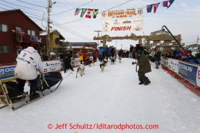 Martin Buser and team cross the finish line in Nome in 17th place on Wednesday March 13, 2013. Iditarod Sled Dog Race 2013Photo by Jeff Schultz copyright 2013 DO NOT REPRODUCE WITHOUT PERMISSION