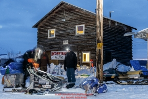 Allen Moore packs supplies into his sled during a short stop in the early morning at the Kaltag checkpoint on Sunday March 13th during the 2016 Iditarod.  Alaska    Photo by Jeff Schultz (C) 2016  ALL RIGHTS RESERVED