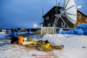 Mats Pettersson snacks his dogs in the early morning at the Kaltag checkpoint on Sunday March 13th during the 2016 Iditarod.  Alaska    Photo by Jeff Schultz (C) 2016  ALL RIGHTS RESERVED