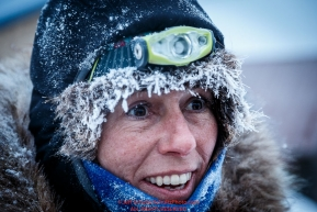 Jodi Bailey is all smiles after coming off the last stretch of Yukon River running in the morning at the Kaltag checkpoint on Sunday March 13th during the 2016 Iditarod.  Alaska    Photo by Jeff Schultz (C) 2016  ALL RIGHTS RESERVED