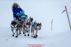 Karin Hendrickson runs up the Yukon River bank in the morning into the Kaltag checkpoint on Sunday March 13th during the 2016 Iditarod.  Alaska    Photo by Jeff Schultz (C) 2016  ALL RIGHTS RESERVED
