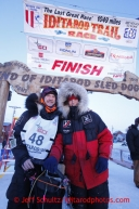 Second place finisher Aliy Zirkle, right, poses with her husband Allen Moore at the finish line shorlty after Allen finished in 33rd place  on Thursday March 14, 2013. Iditarod Sled Dog Race 2013Photo by Jeff Schultz copyright 2013 DO NOT REPRODUCE WITHOUT PERMISSION