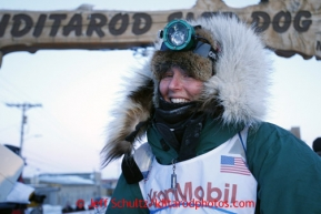 Paige Drobny poses at the finish line after finishing in 34th place on Thursday March 14, 2013. Iditarod Sled Dog Race 2013Photo by Jeff Schultz copyright 2013 DO NOT REPRODUCE WITHOUT PERMISSION