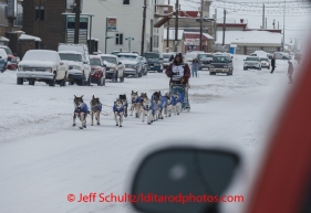 Bob Bundtzen runs up front street in Nome on Friday March 14 during the 2014 Iditarod Sled Dog Race.PHOTO (c) BY JEFF SCHULTZ/IditarodPhotos.com -- REPRODUCTION PROHIBITED WITHOUT PERMISSION