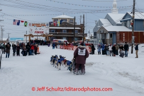 Bob Bundtzen runs up and into the finish chute in Nome on Friday March 14 during the 2014 Iditarod Sled Dog Race.PHOTO (c) BY JEFF SCHULTZ/IditarodPhotos.com -- REPRODUCTION PROHIBITED WITHOUT PERMISSION