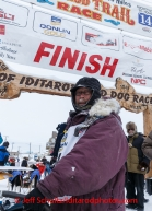 Bob Bundtzen poses at the finish line in Nome on Friday March 14 during the 2014 Iditarod Sled Dog Race.PHOTO (c) BY JEFF SCHULTZ/IditarodPhotos.com -- REPRODUCTION PROHIBITED WITHOUT PERMISSION
