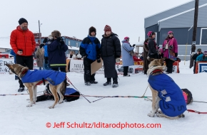 Race fans watch Bob Bundtzen 's dogs in Nome on Friday March 14 during the 2014 Iditarod Sled Dog Race.PHOTO (c) BY JEFF SCHULTZ/IditarodPhotos.com -- REPRODUCTION PROHIBITED WITHOUT PERMISSION