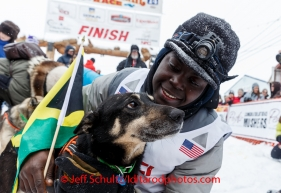 Newton Marshall poses with his lead dog in the finish chute after arriving in 43rd place in Nome on Friday March 14 during the 2014 Iditarod Sled Dog Race.PHOTO (c) BY JEFF SCHULTZ/IditarodPhotos.com -- REPRODUCTION PROHIBITED WITHOUT PERMISSION