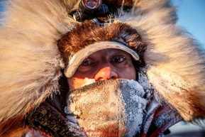 Hugh Neff is bundled up as he arrives at the Koyuk checkpoint on Monday March 14th during the 2016 Iditarod.  Alaska    Photo by Jeff Schultz (C) 2016  ALL RIGHTS RESERVED