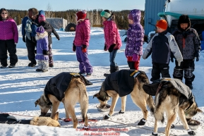 Youngsters watch Pete Kaiser dogs at the Elim checkpoint on Monday March 14th during the 2016 Iditarod.  Alaska    Photo by Jeff Schultz (C) 2016  ALL RIGHTS RESERVED