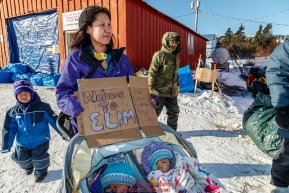 Local resident Sabrina Aukonn and her two daughters greet mushers at the Elim checkpoint on Monday March 14th during the 2016 Iditarod.  Alaska    Photo by Jeff Schultz (C) 2016  ALL RIGHTS RESERVED