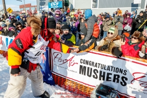 Mitch Seavey greets the crowd after winning his third Iditarod in record time of 8 days, 3 hours, 40 minutes and 13 seconds in Nome during the 2017 Iditarod on Tuesday afternoon March 14, 2017.Photo by Jeff Schultz/SchultzPhoto.com  (C) 2017  ALL RIGHTS RESERVED