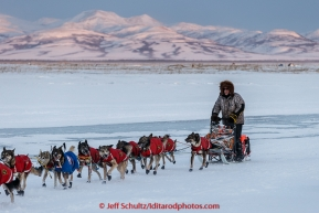 Jeff King runs on the slough arrivng at the Unalakleet  checkpoint at sunset on Sunday  March 15, 2015 during Iditarod 2015.  (C) Jeff Schultz/SchultzPhoto.com - ALL RIGHTS RESERVED DUPLICATION  PROHIBITED  WITHOUT  PERMISSION