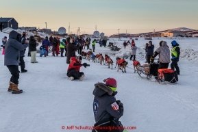 Jeff King arrives to a crowd on the slough at Unalakleet  checkpoint at sunset on Sunday  March 15, 2015 during Iditarod 2015.  (C) Jeff Schultz/SchultzPhoto.com - ALL RIGHTS RESERVED DUPLICATION  PROHIBITED  WITHOUT  PERMISSION