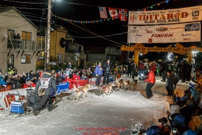 Dallas Seavey runs into the chute to win the 44th running of the Iditarod Sled Dog Race in Nome on Tuesday March 15th during the 2016 Iditarod in record time of 8 Days 11 hours 20 minutes 16 seconds   Photo by Jeff Schultz (C) 2016  ALL RIGHTS RESERVED