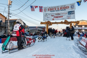 Aliy Zirkle arrives at the finish line in Nome for a third place finish on Tuesday March 15th during the 2016 Iditarod.  Alaska    Photo by Jeff Schultz (C) 2016  ALL RIGHTS RESERVED