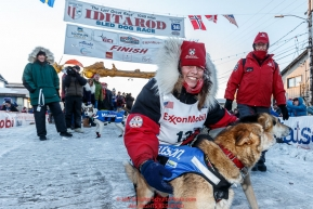 Aliy Zirkle poses with her lead dogs shortly after crossing the finish line in Nome for a third place finish on Tuesday March 15th during the 2016 Iditarod.  Alaska    Photo by Jeff Schultz (C) 2016  ALL RIGHTS RESERVED