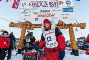 Aliy Zirkle at her sled at the finish line in Nome for a third place finish on Tuesday March 15th during the 2016 Iditarod.  Alaska    Photo by Jeff Schultz (C) 2016  ALL RIGHTS RESERVED
