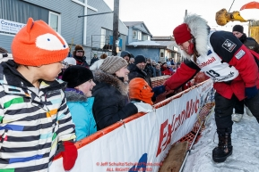 Aliy Zirkle greets the well-wishing crowd after her arrival at the finish line in Nome for a third place finish on Tuesday March 15th during the 2016 Iditarod.  Alaska    Photo by Jeff Schultz (C) 2016  ALL RIGHTS RESERVED