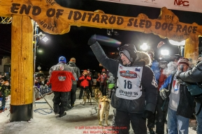 Dallas Seavey waves to the crowd after winning the 44th running of the Iditarod Sled Dog Race in Nome on Tuesday March 15th during the 2016 Iditarod in record time of 8 Days 11 hours 20 minutes 16 seconds Photo by Jeff Schultz (C) 2016  ALL RIGHTS RESERVED
