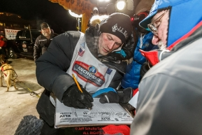 Dallas Seavey signs in after winning the 44th running of the Iditarod Sled Dog Race in Nome on Tuesday March 15th during the 2016 Iditarod in record time of 8 Days 11 hours 20 minutes 16 seconds Photo by Jeff Schultz (C) 2016  ALL RIGHTS RESERVED